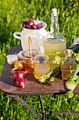 Onion juice, onion syrup and onion wine on a table outdoors (natural remedies)