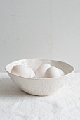 A bowl with white eggs