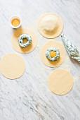 Making of breakfast spinach and ricotta ravioli with egg yolk, using fresh pasta