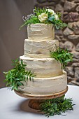 Naked wedding cake on a cake stand