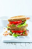 Toasted sandwiches with bacon, tomatoes and lettuce
