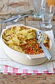 Potato bake with mince, carrots and peas