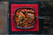 Rabbit cooked with dried plums and cinnamon