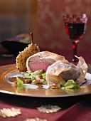 Roast wild boar in filo pastry with pointed cabbage and sour cream sauce (Christmas)
