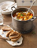 Potato goulash with pumpkin and walnut bread