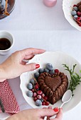 Mini bundt cake in a bowl with fresh fruit for dessert