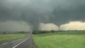 Tornadoes crossing a road