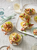 Grilled potato halves with pumpkin ragout and bacon crisps