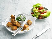 Chicken nuggets with a herb dip and salad