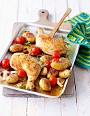 Chicken legs with potatoes and cherry tomatoes