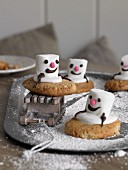 Snowman biscuits with marshmallows