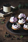 Blackcurrant and white chocolate cupcakes on a metal tray