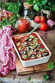 Zucchini and eggplant rolls stuffed with feta and baked in tomato sauce
