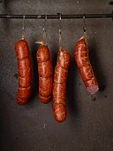 Susländer pork sausages hanging on hooks in a row