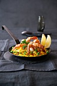Paella in an iron pan