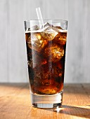Cola with ice cubes in a glass