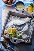 Fish in a salt crust with lemons