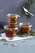 Dried tomatoes in glass jars for gifting
