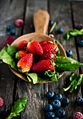Strawberries, spinach, raspberries and blueberries