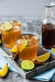 Homemade cola with ice cubes and lime slices