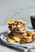 Vegan spelt pancakes with bananas, goji berries and coconut