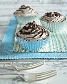 Cupcakes with chocolate biscuit crumbs