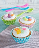 Cupcakes topped with colourful candies