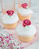 Cupcakes with fondant icing and sugar roses