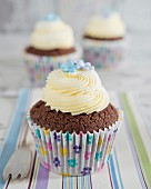 Chocolate cupcakes with buttercream and sugar flowers