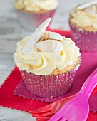 Cupcake with buttercream and topped with a shell