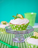 Cupcake with lime frosting and mint