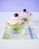 Cupcakes with blueberry frosting and blueberries
