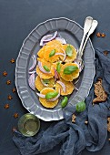 Orange salad with red onions and basil