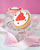 A cupcake decorated with a fondant heart