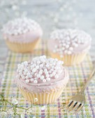 Cupcakes with buttercream and white sugar beads