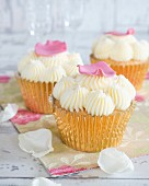 Cupcakes with buttercream and flower petals
