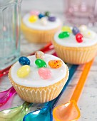 Cupcakes with fondant icing and colourful jelly beans