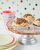 Cupcakes with buttercream, caramel sauce and chocolate sprinkles