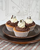 Cupcakes with chocolate cream and chocolate rolls