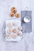 Walnut and orange cookies dusted with icing sugar