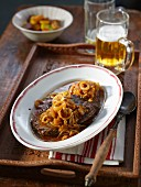 Roast beef and onions with beer