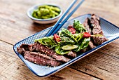 Steak with spinach leaves and a wasabi-avocado dip (Japan)