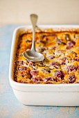Cherry clafoutis in an ovenproof dish