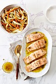 Poached salmon fillets and spring vegetables