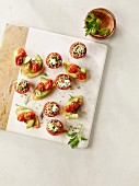 Stuffed tomatoes and avocado and tomato crostini