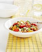 Chickpea salad with tomatoes, feta and orange