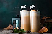 Caffe lattes with pumpkin puree, caramel and cream