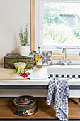 Tea towel hung over vintage-style sink with accessories