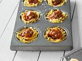 Spaghetti muffins in a muffin tray