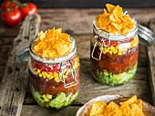 Layered taco salad in glasses